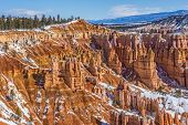 stock photo of hoodoo  - Colorful hoodoos and other formations make a beautiful landscape in Bryce Canyon National Park - JPG
