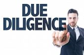 stock photo of diligent  - Business man pointing the text - JPG