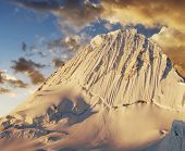 Beautiful mountain Alpamayo on sunset