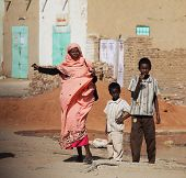 SUDAN - JANUARY 09: Sudanese people walking from a bazaar in rural area near Khartoum on January 29,