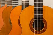 Row Of Classical Acoustic Guitars In Musical Store. Close-up View.