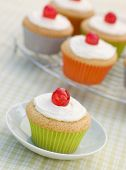 Iced Cup Cakes with Glace Cherries