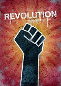 stock photo of fist  - Revolution graffiti on a wall with black raised fist - JPG