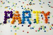 picture of birthday party  - Party word written with small balls on background of confetti - JPG
