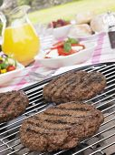 Burgers Cooking On Barbeque Grill