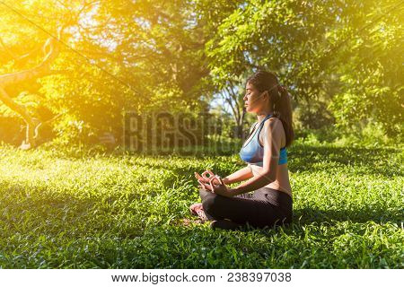 poster of Yoga In The Park, Outdoor With Effect Light, Health Woman, Yoga Woman. Yoga Lifestyle Wellness Healt