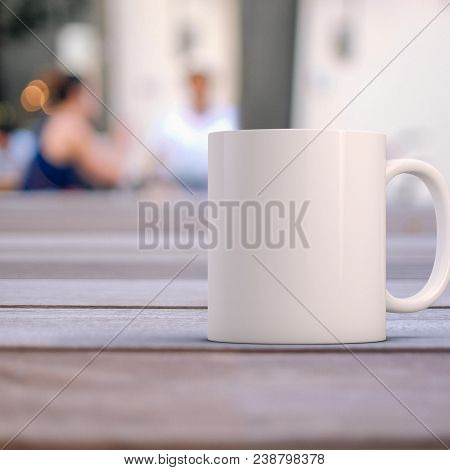 poster of White Coffee Mug Mockup. Closeup Of A White Blank Mug On A Wooden Table Outside A Cafe. Great For Ov