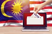 Online Vote , Poll, Exit Poll For Malaysia General Election Concept. Close Up Hand Of A Person Casti poster