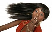 stock photo of african american hair styles  - african american girl swing her head with surprised expression - JPG