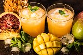 Jars With Various Cold-pressed Raw Tropical Fruit Juice Or Smoothie. Pineapple, Mango And Orange Mix poster