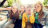 friendship and people concept - happy teenage friends or high school students having fun and making  poster