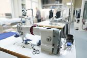 Professional Sewing Machine On The Background Of Atelier Studio. Workplace Of Tailor - Sewing Machin poster