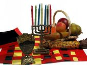 pic of unity candle  - the 7 principle items of kwanzaa over white - JPG