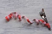 Dietary Recipe Dishes For Lunch, Measuring Tape And Fork And Knife At White Wooden Background/ Conce poster
