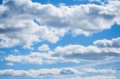 Blue Sky Natural Landscape Scene, Blue Sky Background With White Clouds In The Sky Lit By Sunlight poster