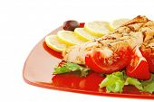 grilled salmon steak on red plate with tomatoes