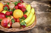Fruits Are Represented In Healthy Eating - Tasty And Juicy Fruit In A Wicker Basket Basket poster