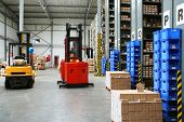 stock photo of lift truck  - Busy warehouse with pallet trucks working - JPG