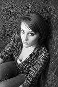 Beautiful Young Woman Sitting In Corner