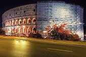 Colosseum With Scaffolding Under Restoration At Night Rome, Italy. Roman Amphitheatre With Light Ill poster