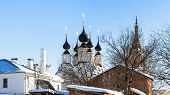 Cityscape Of Suzdal Town With Church Of Antipas, Bishop Of Pergamon (antipiev Church) And Church Of  poster