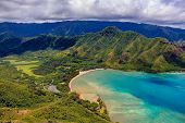 Aerial View Oahu Coastline And Mountains In Honolulu Hawaii From A Helicopter poster