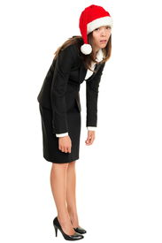 picture of adversity humor  - Christmas business woman tired wearing santa hat standing bored bending over - JPG