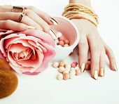 Woman Hands With Golden Manicure And Many Rings Holding Brushes, Makeup Artist Stuff Stylish, Pure P poster