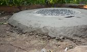 New Septic Tank Hole. Sewer Tank Hole Installation For House Outdoors poster