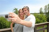 Couple in vacation taking picture of each other