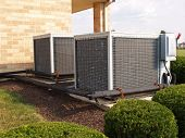stock photo of air conditioner  - two heavy duty iindustrical size air conditioner units - JPG