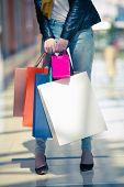 Woman Holding Many Colorful Shopping Bags Sale Concept poster