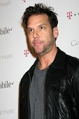 LOS ANGELES - NOV 16:  Dane Cook arrives at the Google Music Launch at Mr. Brainwash Studio on Novem