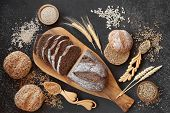 High fibre german rye bread loaf with sour dough & seeded rolls, loose grain & seeds. High in vitami poster