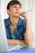Student devolved to do her homework while listening music
