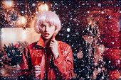 Red Outfit Christmas. Christmas Celebration. Girl Pink Wig Leather Jacket At Home Near Christmas Tre poster