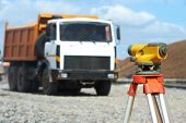 image of geodesic  - Surveying measuring equipment level theodolite on tripod at construction building area site - JPG