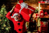 Present Box. Santa Claus Man Holds Christmas Gift Box. Christmas, Winter, Happiness, Presents. New Y poster