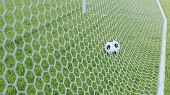 3d Illustration Soccer Ball Flew Into The Goal. Soccer Ball Bends The Net, Against The Background Of poster