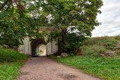 Fredrikshamn Gate Surrounded By Trees In Overcast Day In Hdr Processing, Annenkrone, Vyborg, Leningr poster