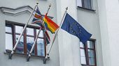Rainbow Flag Or Pride Flag, Union Jack Or Great Britain Flag And United Europe Flag On The Facade Of poster