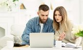 Millennial Couple Managing Expenses With Laptop And Checking Accountancy And Bills, Panorama poster