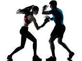 personal trainer man coach and woman exercising boxing silhouette  studio isolated on white background