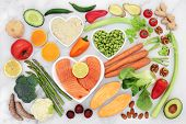 Healthy heart food for fitness with fish, fruit, vegetables, nuts, dips & spice. Health foods high i poster
