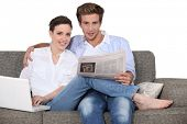 foto of concubine  - Couple relaxing in their living room - JPG