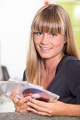 Blond girl holding CD