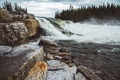 Waves And Splashes Of Mountain River On Background Of Forest, Rocks And Dramatic Sky. Forest River W poster
