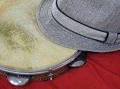Close-up Of A Samba Player (sambista) Hat And A Brazilian Percussion Musical Instrument: pandeiro  poster