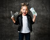 Lucky Rich Kid Girl Millionaire Is Holding In Hands, Shaking, Waving Us Bundles Of Money Euro Hundre poster