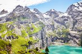 Amazing Top View Of Oeschinensee Lake By Kandersteg, Switzerland. Turquoise Lake Surrounded By Steep poster